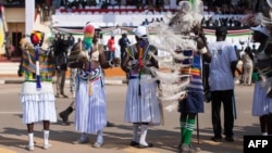 South Sudanese dance and wave flags during celebrations marking three years of Independence at a stadium in Juba, July 9, 2014.
