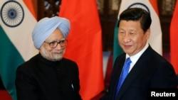 2013年10月中国主席习近平会见印度总理辛格