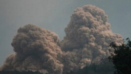 Mount Rokatenda spews volcanic material as it erupts on Palue island, Indonesia, Aug. 11, 2013.