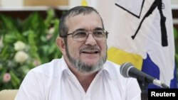 FARC rebel leader Rodrigo Londono, better known by the nom de guerre Timochenko speaks to the media during a news conference after his meeting with Colombia's President Juan Manuel Santos and Cuba's President Raul Castro in Havana, Sept. 23, 2015.