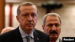Türkiyə prezidenti Rcəb Tayyi Ərdoğan və keçmiş iqtisaiyyat naziri Zəfər Çağlayan