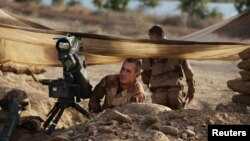 French troops take up positions in northern Mali January 19, as a French-led offensive drives al-Qaida-linked rebels from the larger towns in the region.