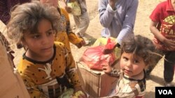 Children in this Mosul suburb, Demerche, say they rely entirely on humanitarian aid for food, and the assistance comes sporadically or sometimes not at all, in Mosul, Iraq, May 4, 2017. (H. Murdock/VOA)