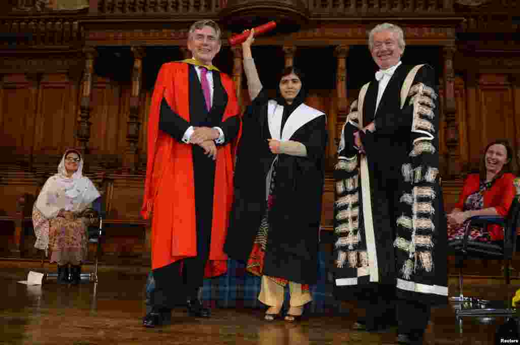 Former UK Prime Minister Gordon Brown (L) and Timothy O'Shea, vice-chancellor and principal of The University of Edinburgh, poses with Malala Yousafzai after she received an Honorary Degree of Master of Arts from Edinburgh University at the inaugural meeting of the Global Citizenship Commission in the McEwan Hall at the University of Edinburgh, Edinburgh, Scotland.