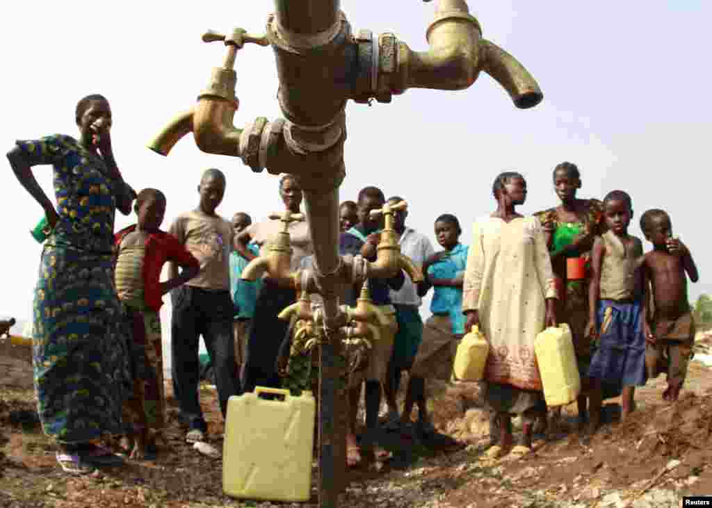 Congolese refugees, displaced by fighting between the Congo army and rebel group Allied Democratic Forces (ADF) last week, gather around dry water taps at Bukanga transit camp in Bundibugyo town camp, 376km (238 miles) southwest of Kampala, Uganda.