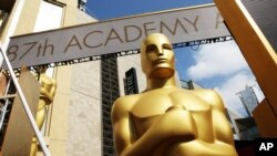 FILE - An Oscar statue is seen as preparations are made for the 87th Academy Awards in Los Angeles, Feb. 21, 2015.