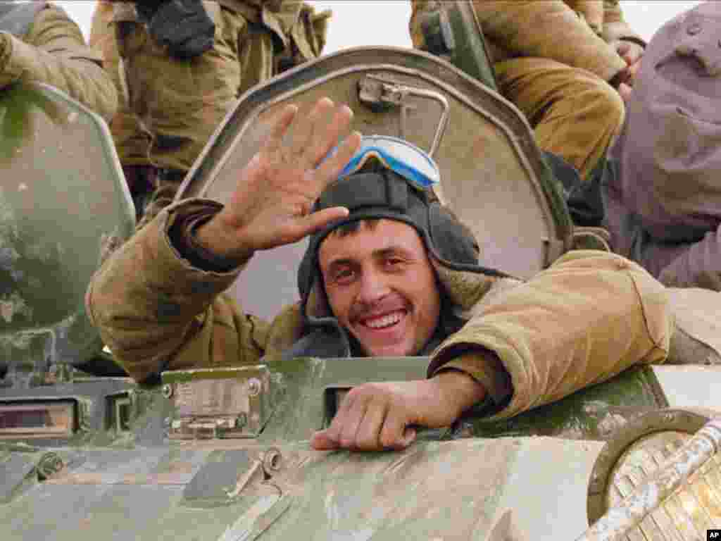 A smile and a wave from a happy Soviet soldier, as his armored convoy makes its way back to the Soviet Union along a north Afghanistan highway in this Sunday, Feb. 7, 1989, file photo. The Soviet Union lost some 15,000 soldiers in the war, which began in