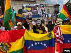 Venezuelan expats are joined by Nicaraguans, Bolivians and others during a protest calling for freedom and democracy in Venezuela, in front of the building of the Organization of American States, in Washington, May 20, 2018.