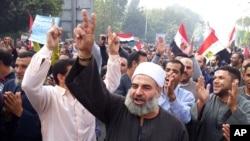 埃及總統穆罕默德•穆爾西的支持者星期六在開羅舉行遊行
