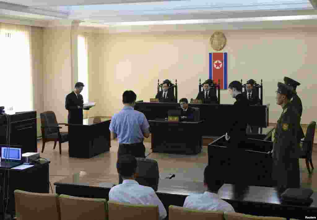 U.S. citizen Matthew Todd Miller (4th right) stands in a witness box during his trial at the North Korean Supreme Court in this undated photo released by North Korea's Korean Central News Agency (KCNA) in Pyongyang, Sept. 14, 2014.