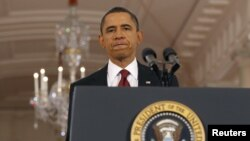 US President Barack Obama approaches the podium in the East Room of the White House in Washington (file photo).