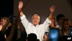 Former Chilean president and billionaire Sebastian Pinera celebrates the first official results that place him first in the elections, in Santiago, Chile, Nov. 19, 2017.