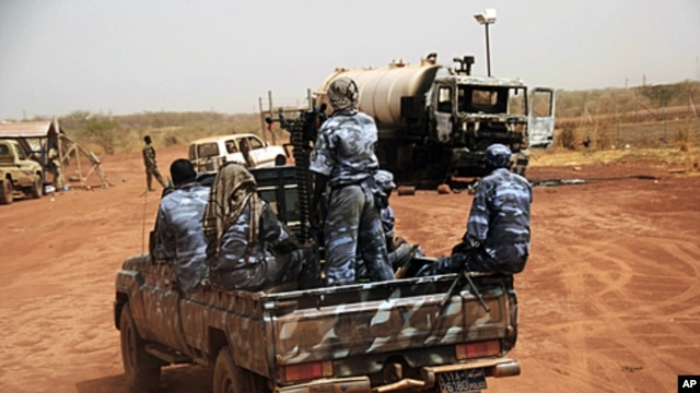 Sudanese armed forces ride a military vehicle at the oil-rich border town of Heglig, Sudan, April 24, 2012. (AP)