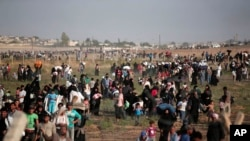 Izbeglice na granici Turske i Sirije