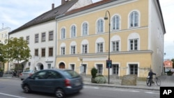 FILE - This Sept. 27, 2012, photo shows an exterior view of Adolf Hitler's birth house, front, in Braunau, Austria. Austria's government said on Mondaythat it plans to tear down the house and replace it with a new building.