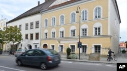 FILE - This Sept. 27, 2012, photo shows an exterior view of Adolf Hitler's birth house, front, in Braunau, Austria.
