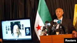 FILE - Abdeltawwab Shahrour, head of the forensic medicine committee in Aleppo, speaks during a news conference in Istanbul, September 10, 2013. Shahrour has said he had documents confirming President Bashar al-Assad's government used chemical weapons.