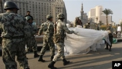 Egyptian Army soldiers remove tents of protesters from Tahrir Square in downtown Cairo, Egypt, Feb 13, 2011