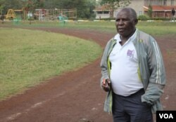 Coach John Mwithiga, who has been training top Kenyan athletes for 25 years, at a track in Nairobi, Kenya, Nov. 6, 2014. (Hilary Heuler / VOA News)