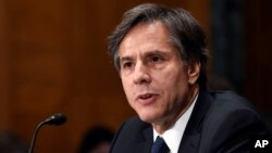 FILE - Deputy Secretary of State Antony Blinken, shown testifying on Capitol Hill last month, is expected to address the jihadist threat with officials in Beijing and Tokyo next week.