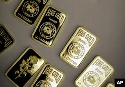 FILE - 10-gram gold bars lie on display in Dubai, United Arab Emirates.