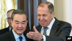 Russian Foreign Minister Sergey Lavrov, right, and China's Defense Minister Wei Fenghe enter a hall during their meeting in Moscow, Russia, April 5, 2018.