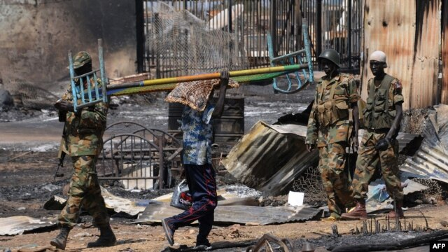 Both men sanctioned by the European Union on July 11, 2014 led forces fighting in Bentiu, the capital of Unity state. The city is shown here in January 2014 after it was recaptured by the Sudan People's Liberation Army (SPLA).