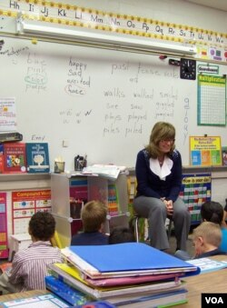 Teacher Sonja Pellerin with first and second-grade students at Hinkley School, which will soon close. (VOA/C. Richard)