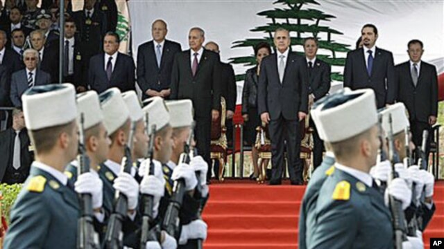 Lebanese President Michel Suleiman, fourth right, Lebanese Prime Minister Saad Hariri, second right, and Lebanese Parliament Speaker Nabih Berri, fifth right, attend military parade marking 67th anniversary of Lebanon's independence from France, in Beirut