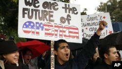 Undocumented college student Jorge Herrera, 18, center, of Carson, Calif., rallies with students and Dream Act supporters in Los Angeles, 18 Dec 2010.