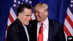 Donald Trump greets Republican presidential candidate, former Massachusetts Gov. Mitt Romney Feb. 2, 2012, in Las Vegas.