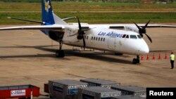 2011年11月7日老挝航空公司飞机在万象机场停机坪上(资料照片)