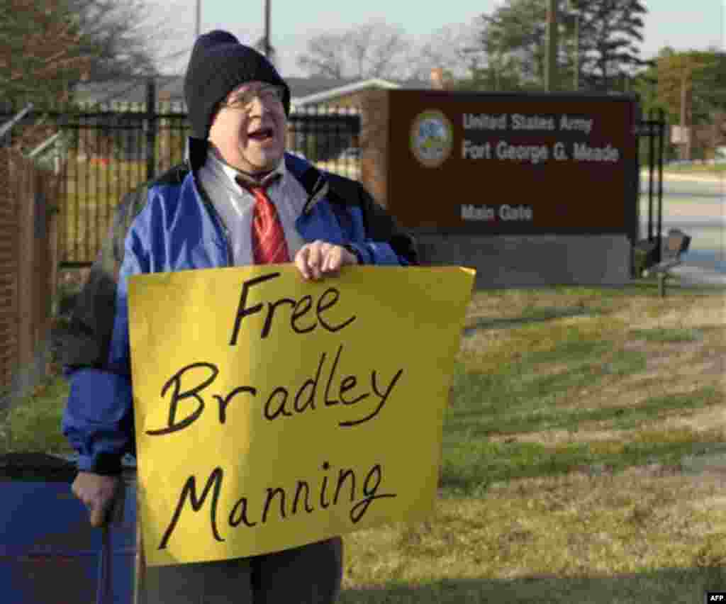 Dave Eberhardt of Baltimore, Md., protests outside Ft. Meade, Md., Friday, Dec. 16, 2011, in support Pfc. Bradley Manning. The U.S. military is making its case for why Manning should be court-martialed on charges of endangering national security by steali