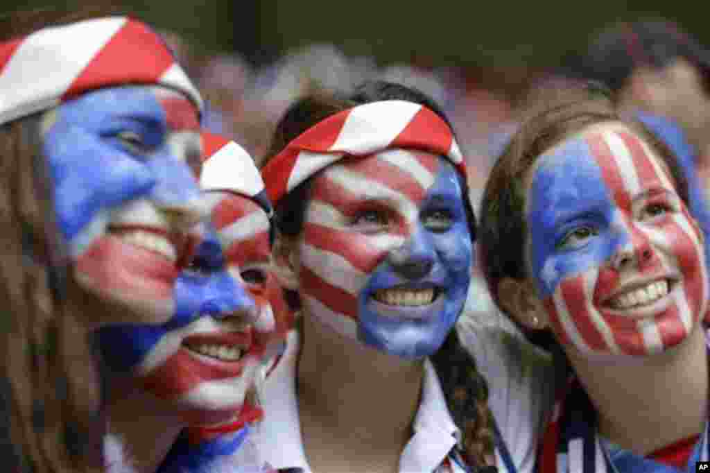 Fans of the United States with painted faces smile in the stands before the FIFA Women's World Cup soccer championship between the U.S. and Japan in Vancouver, British Columbia, Canada, Sunday, July 5, 2015. (AP Photo/Elaine Thompson)