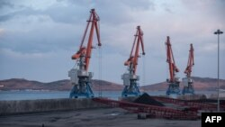 Cranes plus North Korean and Russian coal bound for China are seen at the RasonConTrans coal port at Rajin harbor in the Rason Special Economic Zone, Nov. 21, 2017.