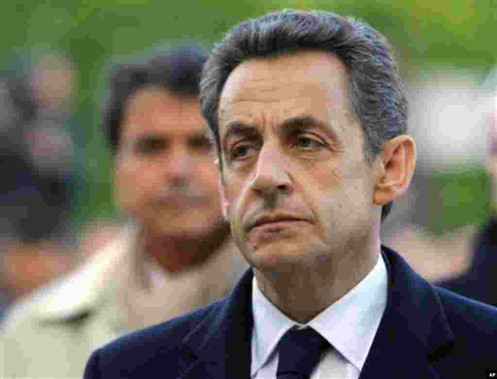 French President and candidate for the French presidential election Nicolas Sarkozy stands before the Armenian Monument during a ceremony marking the 97th anniversary of the Armenian genocide, Tuesday, April. 24, 2012. (AP Photo/Jacques Brinon Pool)