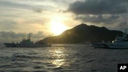 FILE - Japanese Coast Guard vessels sail near a group of disputed islands called Diaoyu by China and Senkaku by Japan.