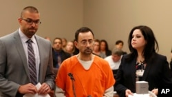 FILE - Dr. Larry Nassar, 54, appears in court for a plea hearing in Lansing, Mich., Nov. 22, 2017. Nasser, a sports doctor accused of molesting girls, pleaded guilty to multiple charges of sexual assault.