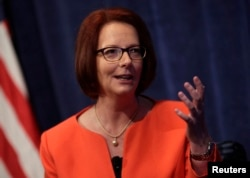 Former Australian Prime Minister Julia Gillard speaks at a policy forum in Washington, Oct. 24, 2013.