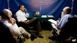 U.S. President Barack Obama is briefed on the situation in Libya on Sunday, during a secure conference call in Rio de Janeiro, Brazil. National Security Advisor Tom Donilon is on the right, Chief of Staff Bill Daley on the left. (Official White House Pho