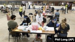 Kent State University Students get their COVID-19 vaccinations in Kent, Ohio, Thursday, April 8, 2021. (AP Photo/Phil Long)