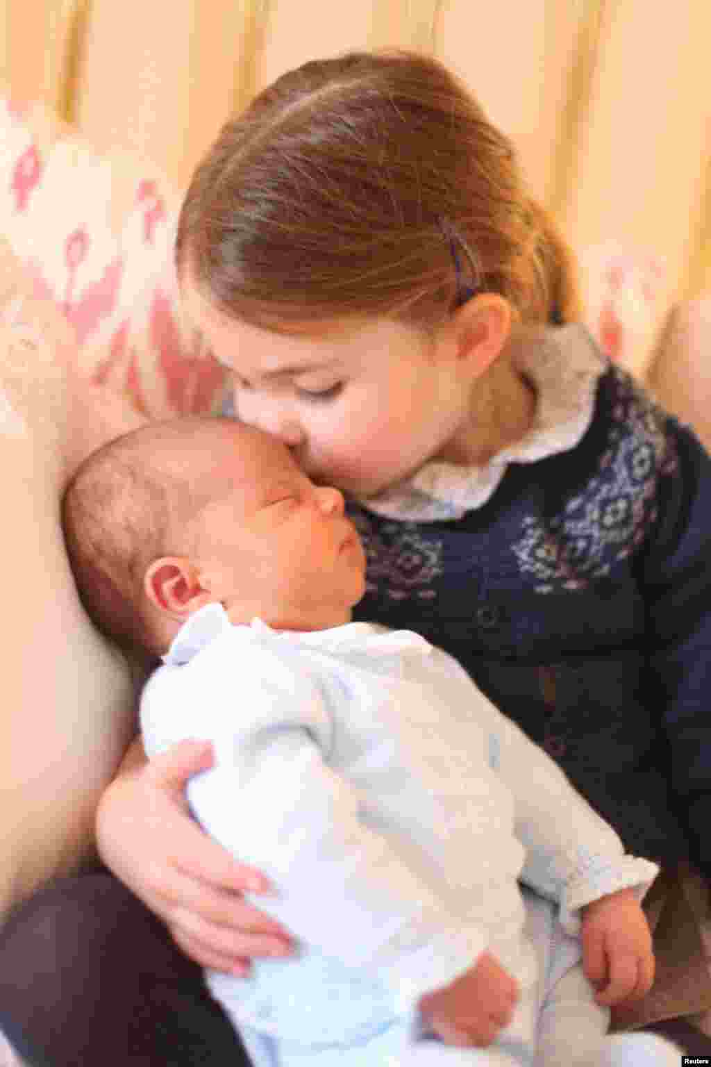 Britain's Princess Charlotte and her brother Prince Louis are seen in this photograph released by Kensington Palace, and taken by Britain's Catherine, Duchess of Cambridge, on Princess Charlotte's third birthday, at Kensington Palace in London.
