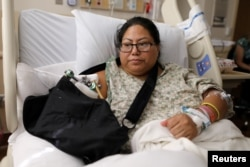 FILE - Paola Bautista, 39, of Fontana, California, sits in her bed at Sunrise Hospital & Medical Center in Las Vegas, Nevada, Oct. 4, 2017. She was one of those shot Oct. 1 at the Route 91 music festival next to the Mandalay Bay Resort and Casino in Las Vegas.