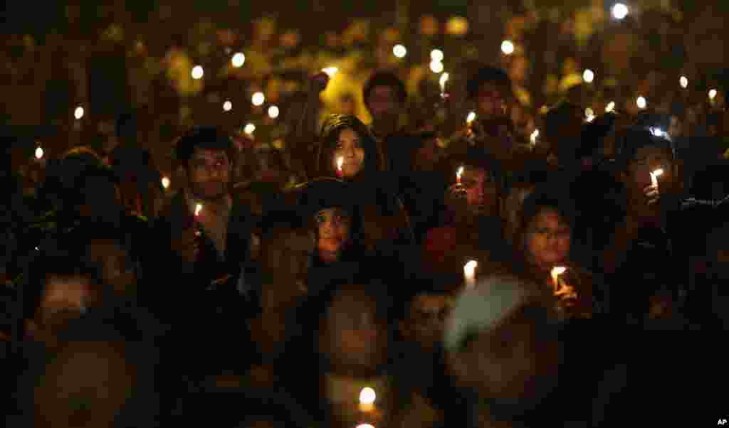 Indians hold candles as they mourn the death of a gang rape victim in New Delhi, India, Saturday, Dec. 29, 2012.