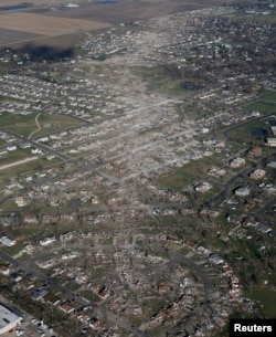 An aerial view shows the path of destruction caused by a tornado that touched down in Washington, Illinois, Nov. 18, 2013.