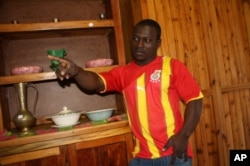 Isaac Donkor, in his Black Stars football jersey, inside his furniture store in Johannesburg