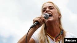 Lilian Tintori, wife of jailed opposition leader Leopoldo Lopez, speaks during a rally against Venezuelan President Nicolas Maduro's government and in support of Lopez, in Caracas, Venezuela, June 8, 2014.