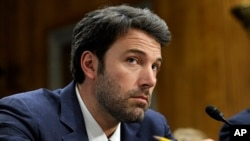 FILE - Actor Ben Affleck, founder of the Eastern Congo Initiative, listens to testimony during the Senate Foreign Relations Committee hearing on the Congo on Capitol Hill in Washington, Feb. 26, 2014.