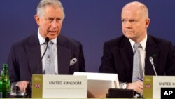 Prince Charles and British Foreign Secretary William Hague address a February meeting of 50 nations declaring a global end to ivory poaching.