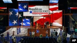 Workers prepare the stage for the Republican National Convention inside the Tampa Bay Times Forum, in Tampa, Florida, August 25, 2012.